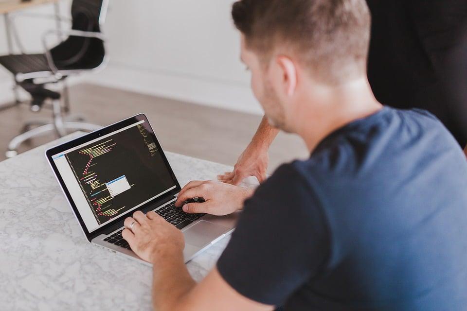 man doing coding